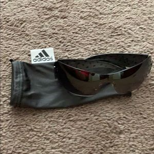 Paula Creamer Sundog sunglasses (adidas bag)